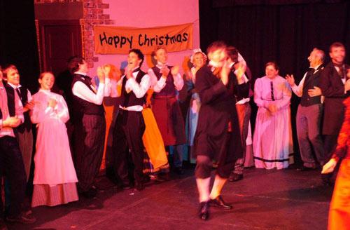 Ebenezer's employers, the Fezziwigs, wish everyone a happy December 25th