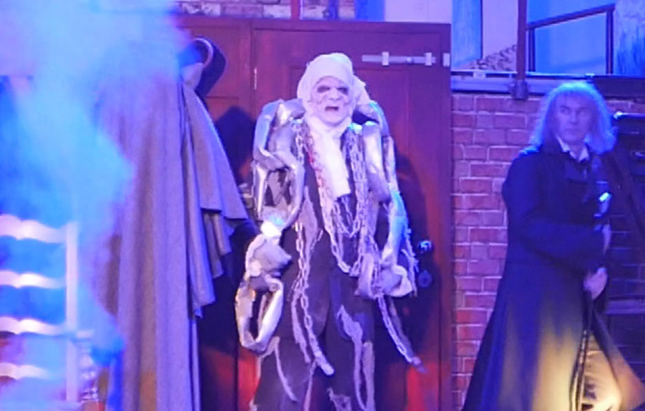 12 Scrooge is visited by his dead partner Jacob Marley